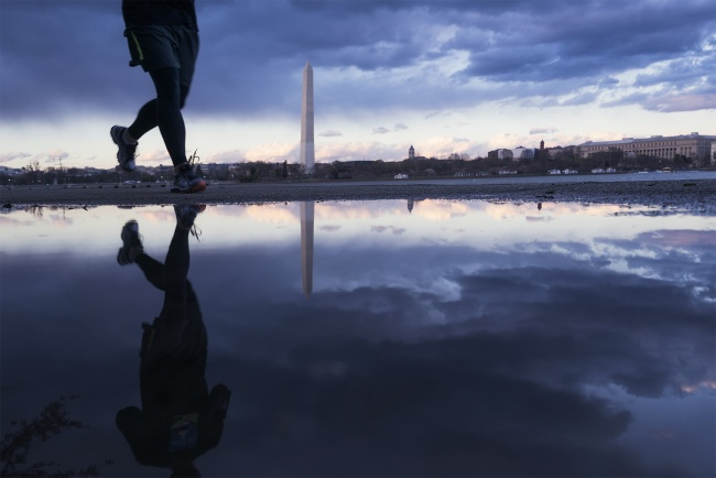 washington dc, jefferson memorial, sunset, moody, clouds, reflection, puddle, rain, snow, runners, running, tidal basin, washington monument, photographer, photo, photography, trip, vacation, adventure, travel, recommendations, road trip