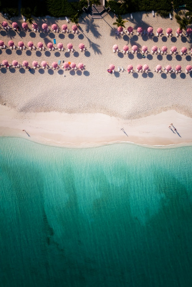 dji mavic pro, from above, turks and caicos, caribbean, island, beach, blue water, weekend getaway, white sand beach, beach umbrellas, pink umbrellas, shadows, beach, flying