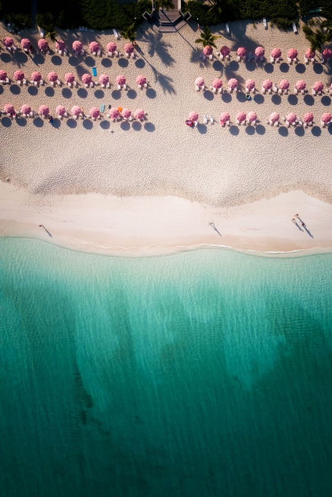 dji mavic pro, from above, turks and caicos, caribbean, island, beach, blue water, weekend getaway, white sand beach, beach umbrellas, pink umbrellas, shadows, beach, flying