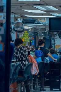hair salon, chinatown, haircut, rainy day, stret photography, blue tones, orange tones, color balance, nyc, new york city, manhattan,