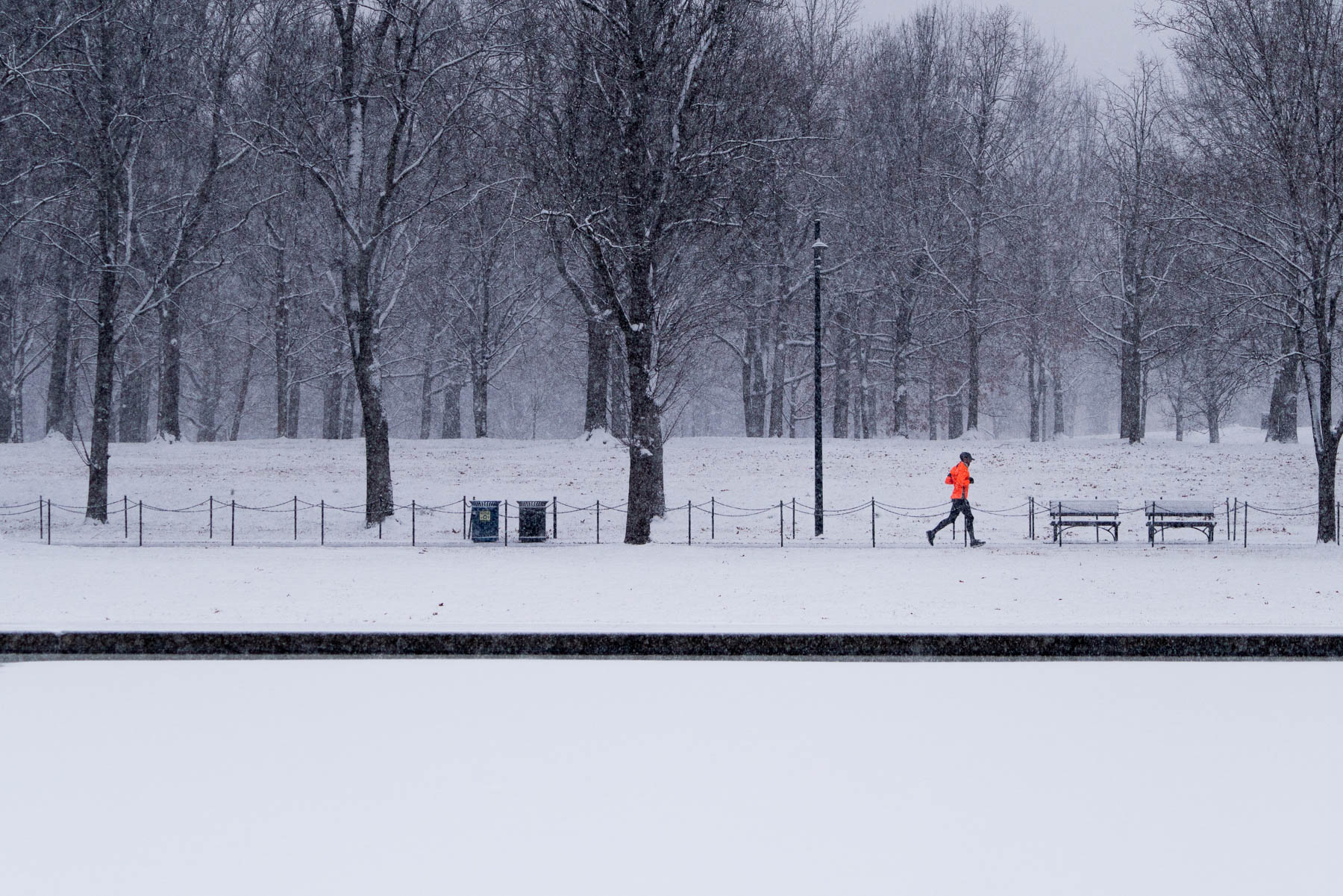 reflecting pool, washington dc, national mall, runner, snow, winter, reflection