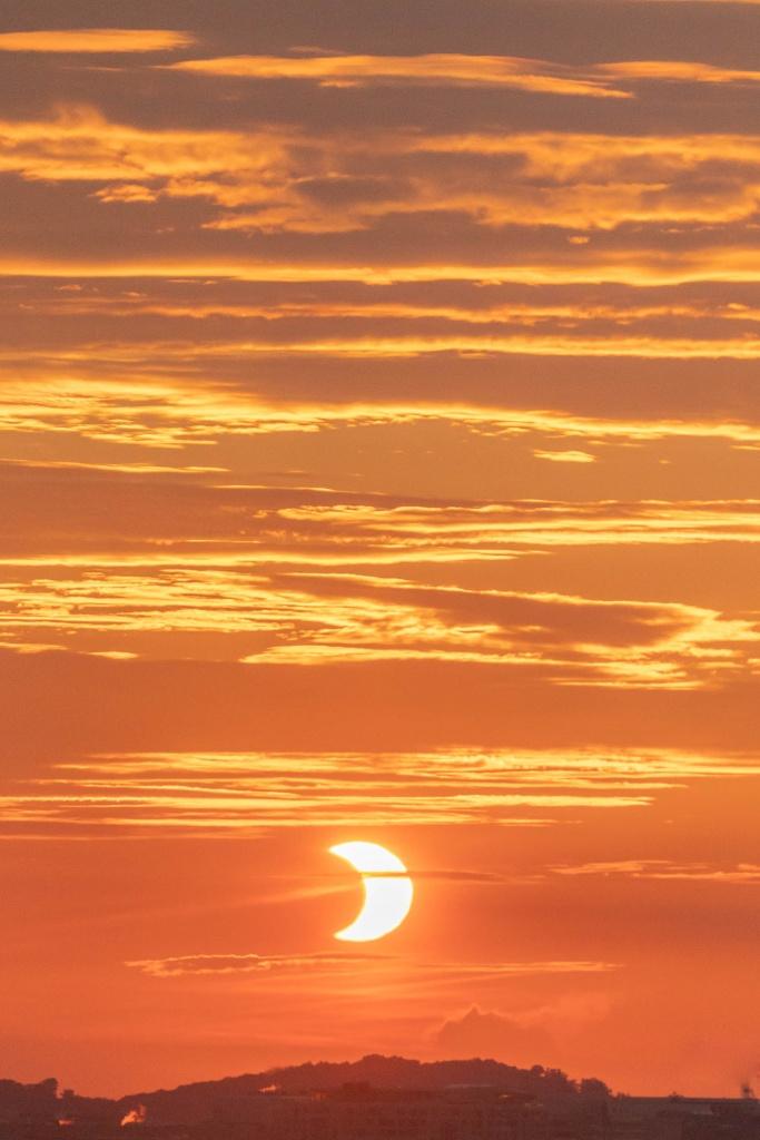 partial solar eclipse, solar eclipse 2021, sunrise, washington dc, virignia, arlington